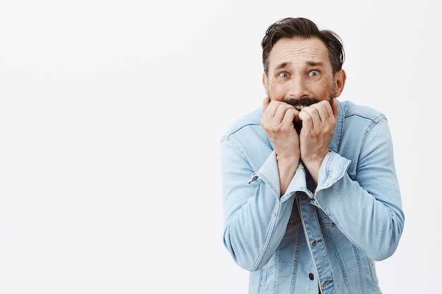 Scared bearded mature man posing Free Photo