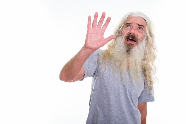 Scared senior bearded man showing stop hand Premium Photo