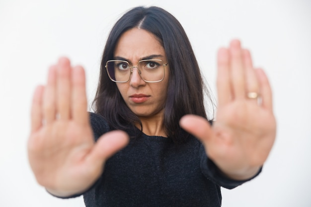 Scared upset woman making stop gesture Free Photo