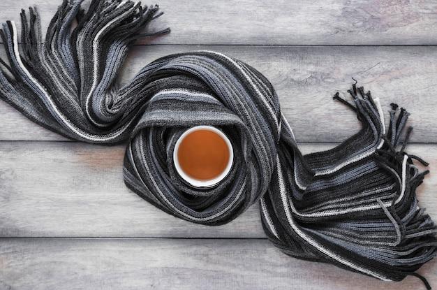 Scarf around mug of tea Free Photo