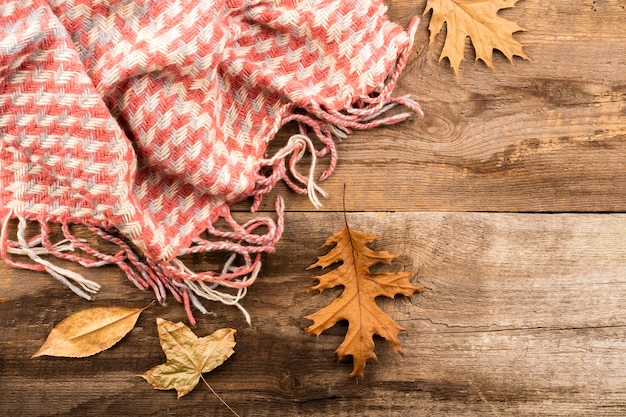 Scarf on wooden background copy space Free Photo