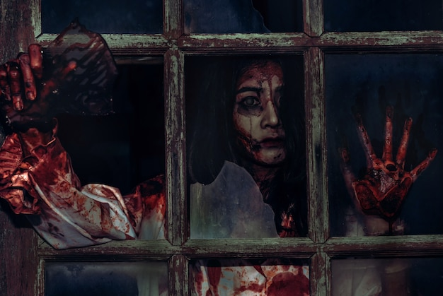 Scary bloody zombie girl Premium Photo