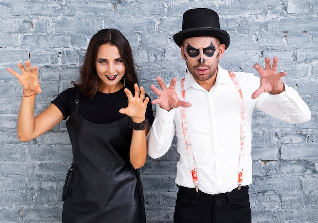Scary man and woman posing for halloween Free Photo