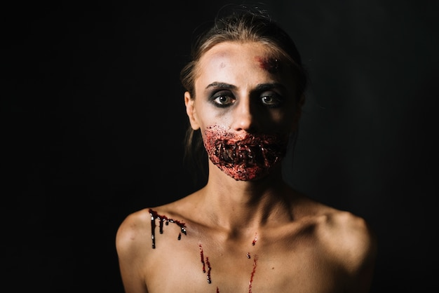 Scary woman with damaged face Free Photo