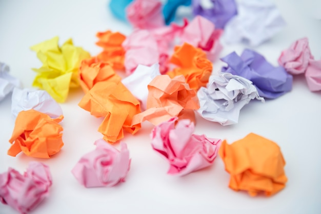 Scattered crumple paper on white background Free Photo