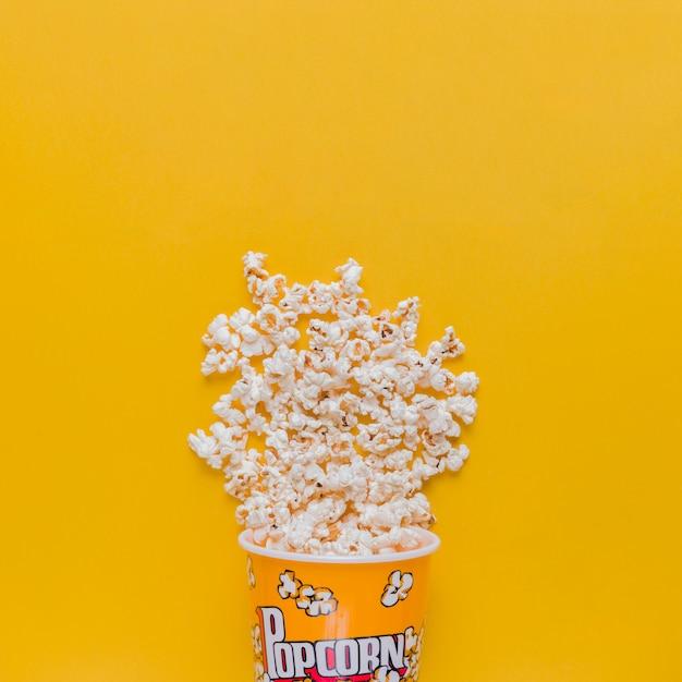Scattered popcorn box Free Photo