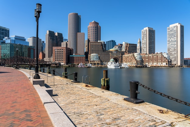 Scene of boston skyline from fan pier at the afternoon with smooth water river, massachusetts Premium Photo