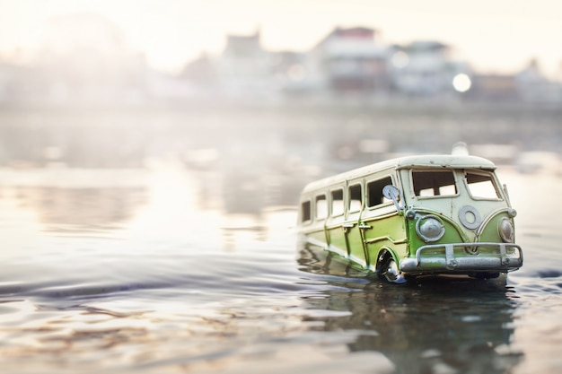 Scene of crashed cars (miniature, toy model ) in flood from natural disasters.selective focus. Premi