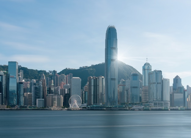 Scene of hong kong cityscape river side in the afternoon with smooth cloud Premium Photo
