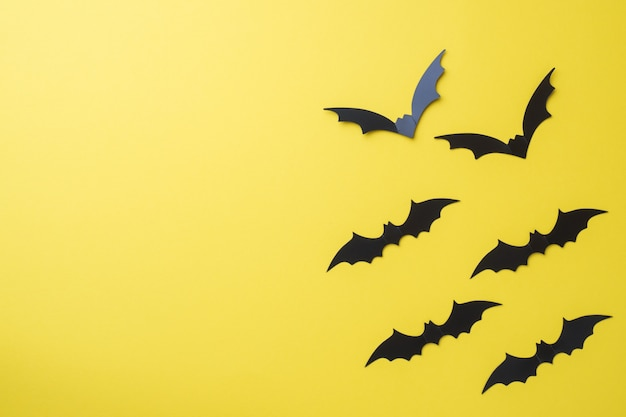 Scenery bats on a yellow background Premium Photo