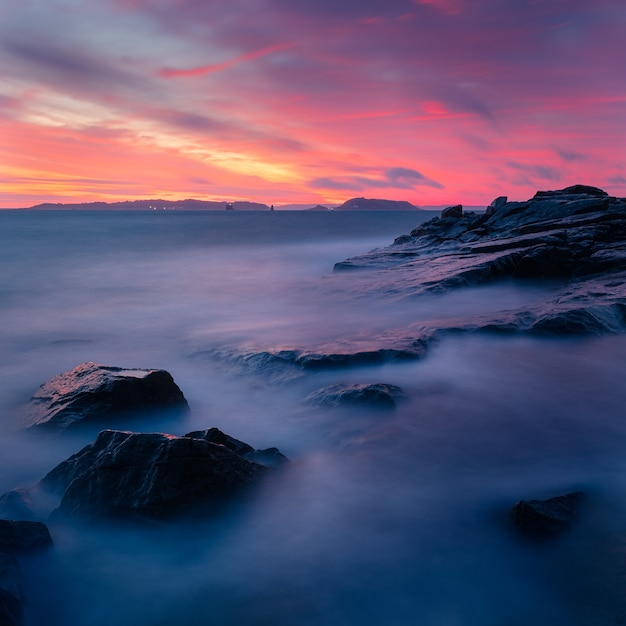 Scenery of a breathtaking colorful sunset over the rock formations Free Photo