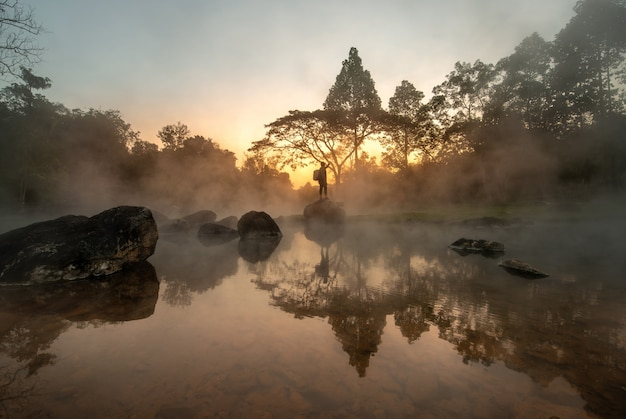 Scenery of sunrise behind hot spring at chae son national park, lampang, thailand Premium Photo