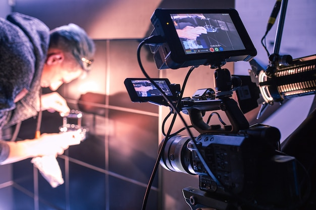 Behind the scenes of filming films or video products and the film crew of the film crew on the set in the pavilion of the film studio. Premium Photo