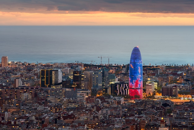 Scenic Aerial View Of Barcelona City Skyscraper And Skyline At Night
