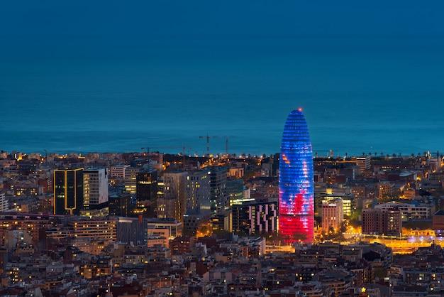 Scenic aerial view of barcelona city skyscraper and skyline at night in barcelona, spain. Premium Photo