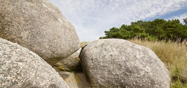 Scenic formation of big round rocks on atlantic shore. arousa island, pontevedra, spain Premium Photo