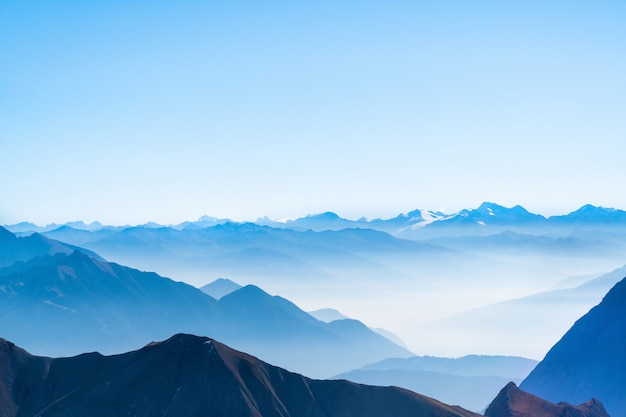 Scenic panorama picture or postcard view of layer mountain, blue sky and cloud background at german alps zugspitze Premium Photo