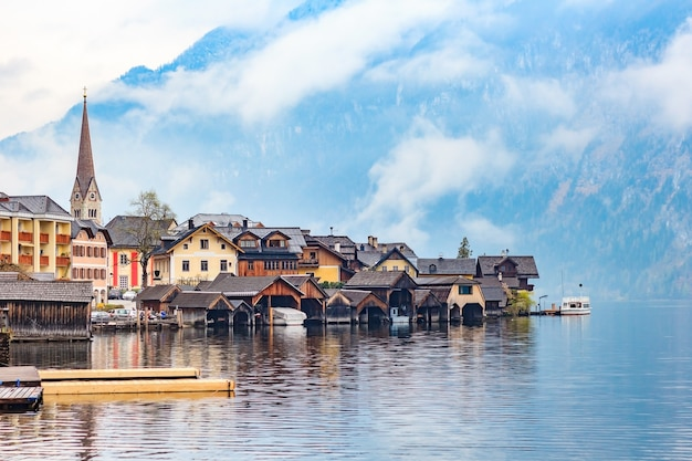 Scenic view of famous hallstatt mountain village with hallstattersee lake and alps mountains summits. Premium Photo