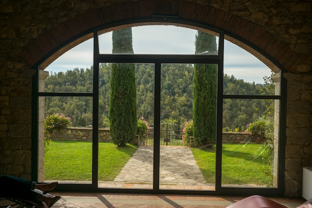 Scenic view of forest seen through window, gaiole in chianti, tuscany, italy Premium Photo
