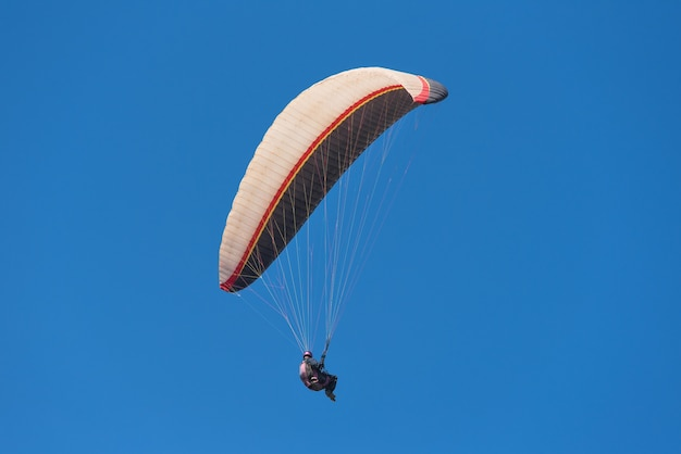 Scenic view of a paraglider on a sunny day. Premium Photo