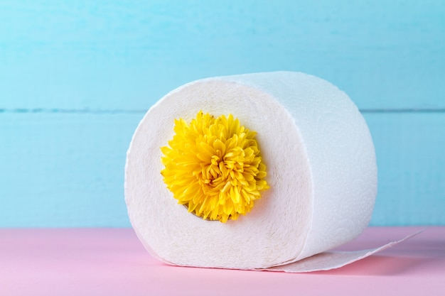 Scented toilet paper and a yellow flower. toilet paper with a smell. hygiene Premium Photo