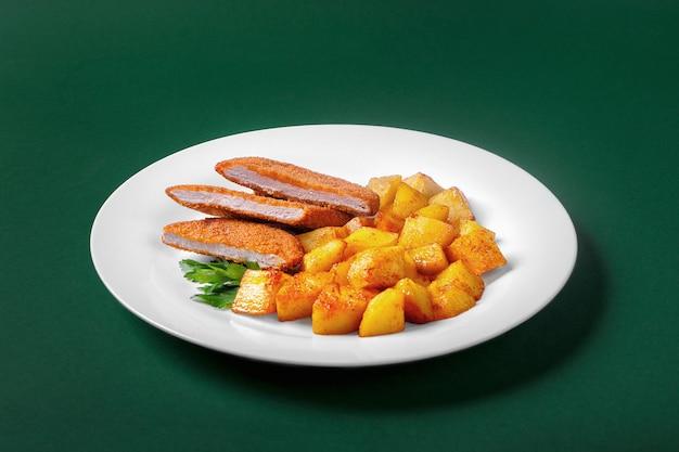 Schnitzel with potatoes for the menu Premium Photo