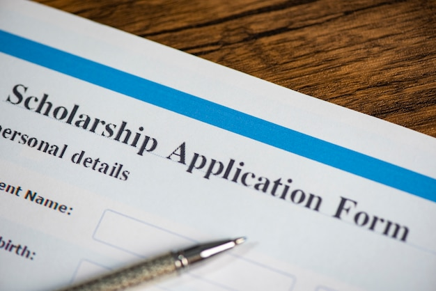Scholarship application form document contract concept with pen for grants education Premium Photo