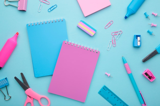 School accessories on blue background. back to school concept, minimalism Premium Photo