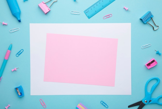 School accessories on blue background with copy space. back to school concept, minimalism Premium Photo