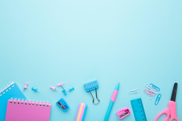 School accessories on blue background Premium Photo
