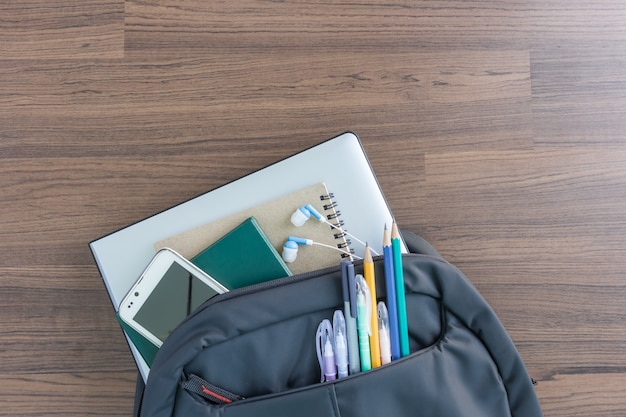 School backpack with accessories for student in top view Premium Photo