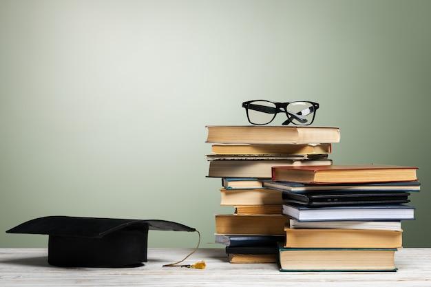 School blackboard with pile of books Premium Photo