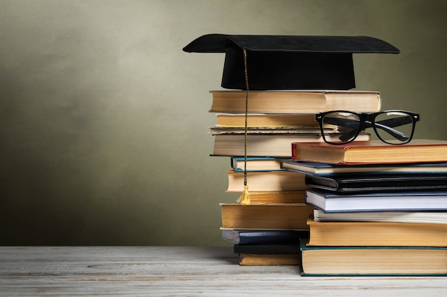 School blackboard with pile of books Premium Photo