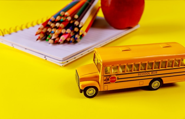 School cocept supplies for the school on yellow surface. Premium Photo