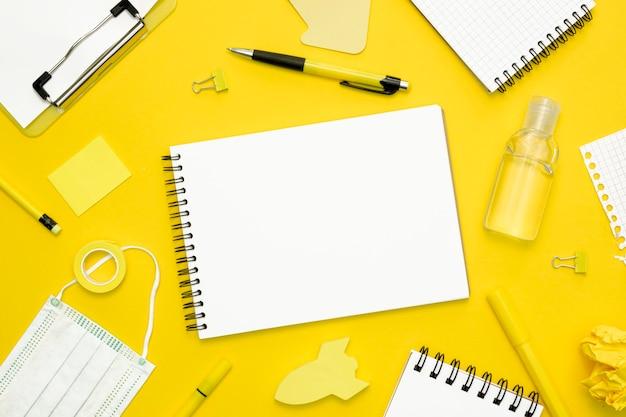 School elements on yellow background Free Photo