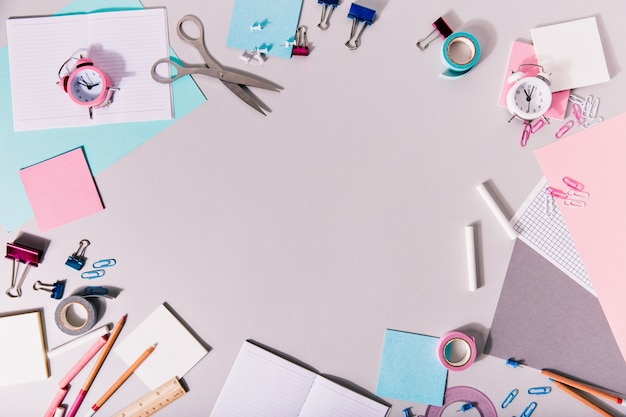 School girlish writing accessories and other stationery form a circle. Free Photo