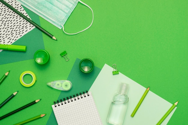 School items on green background Free Photo
