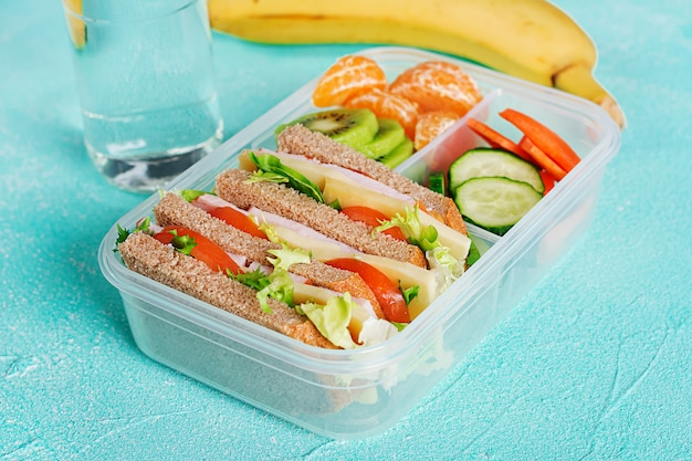 Free Photo School Lunch Box With Sandwich Vegetables Water And Fruits On Table Download a free preview or high quality adobe illustrator ai, eps, pdf and high resolution jpeg versions. school lunch box with sandwich