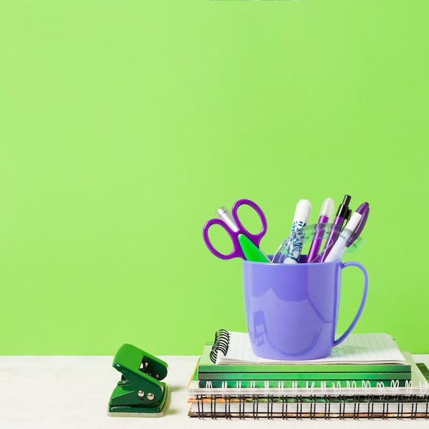 School materials with green background Free Photo