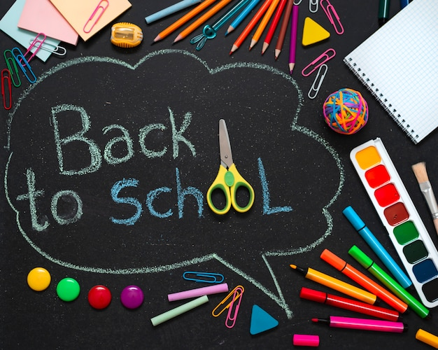 School multi-colored supplies, pencils and a drawn cloud with copy space for text. Free Photo
