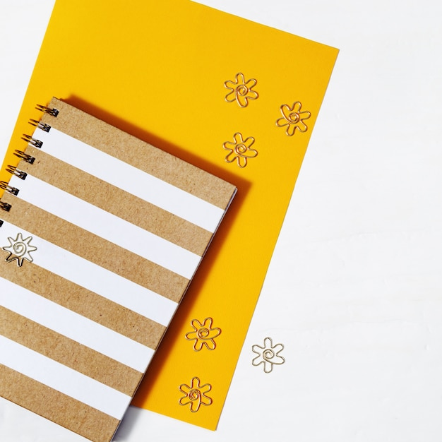 School notebook on spring and gold metal clips Premium Photo