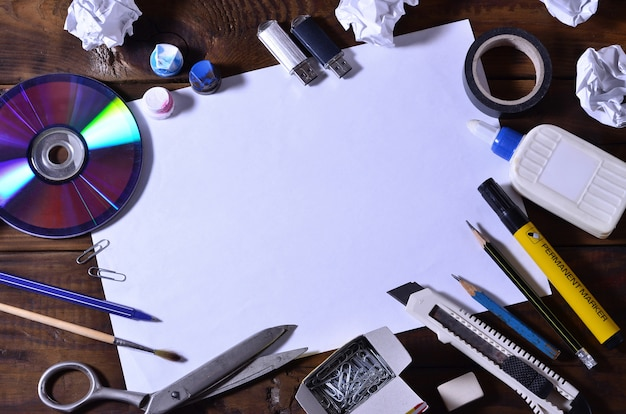 A school or office still life with a white blank sheet of paper Premium Photo