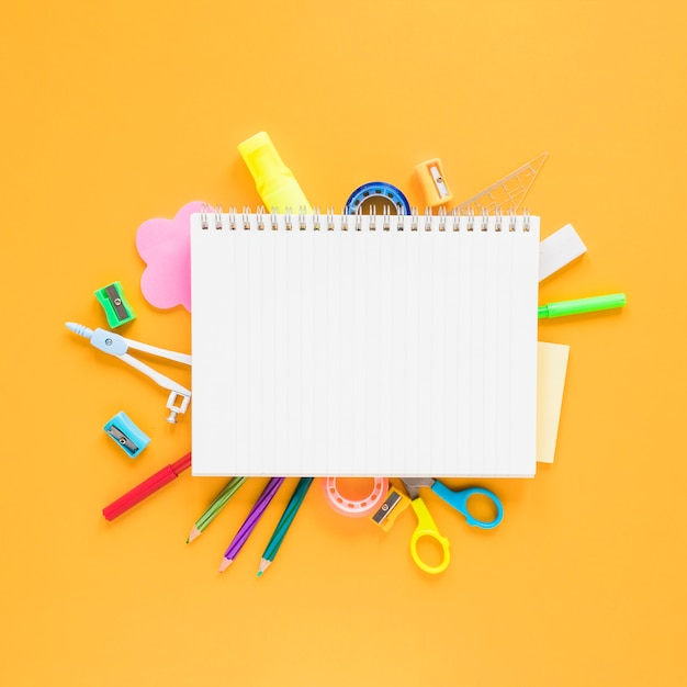 School and office stuff on amber background Premium Photo
