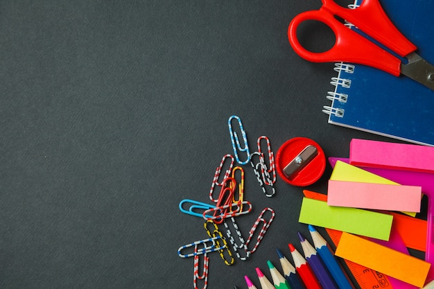 School and office supplies on dark background. top view with copy space Premium Photo