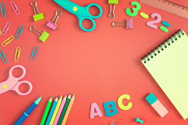 School and office supplies on red Premium Photo