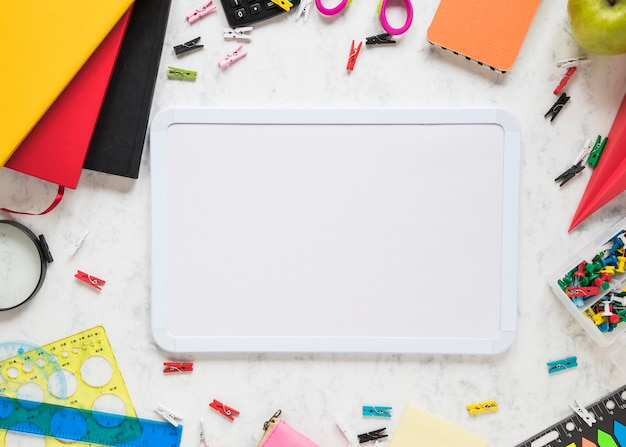School and office supplies on white background Free Photo