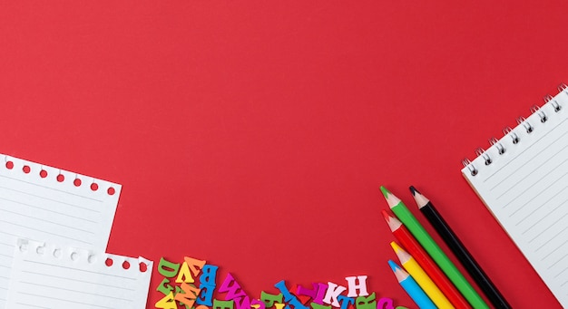 School subjects on a red background, banner Premium Photo