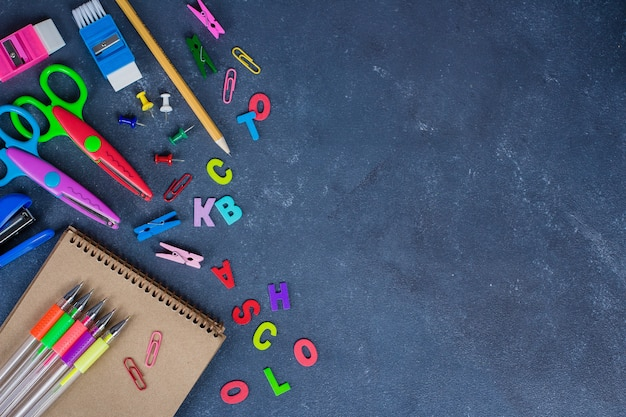School supplies on blackboard background ready for your design Premium Photo