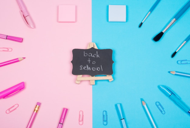 School supplies and a blackboard with back to school Premium Photo