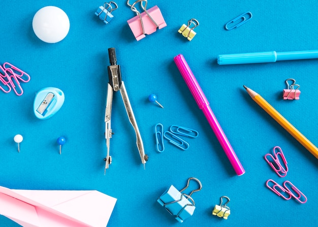 School supplies on blue surface Free Photo